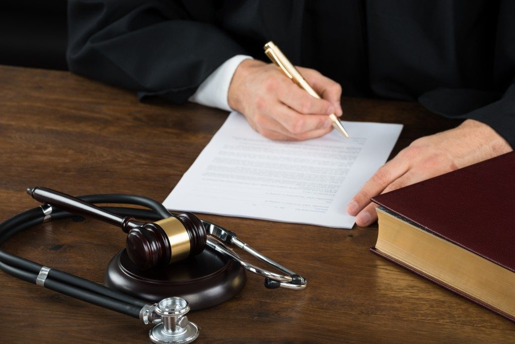 man in legal filed writing a legal document