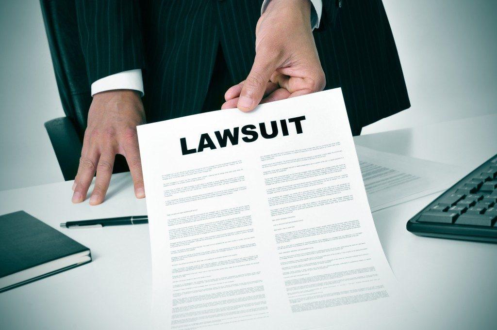 Lawyer showing copy of lawsuit
