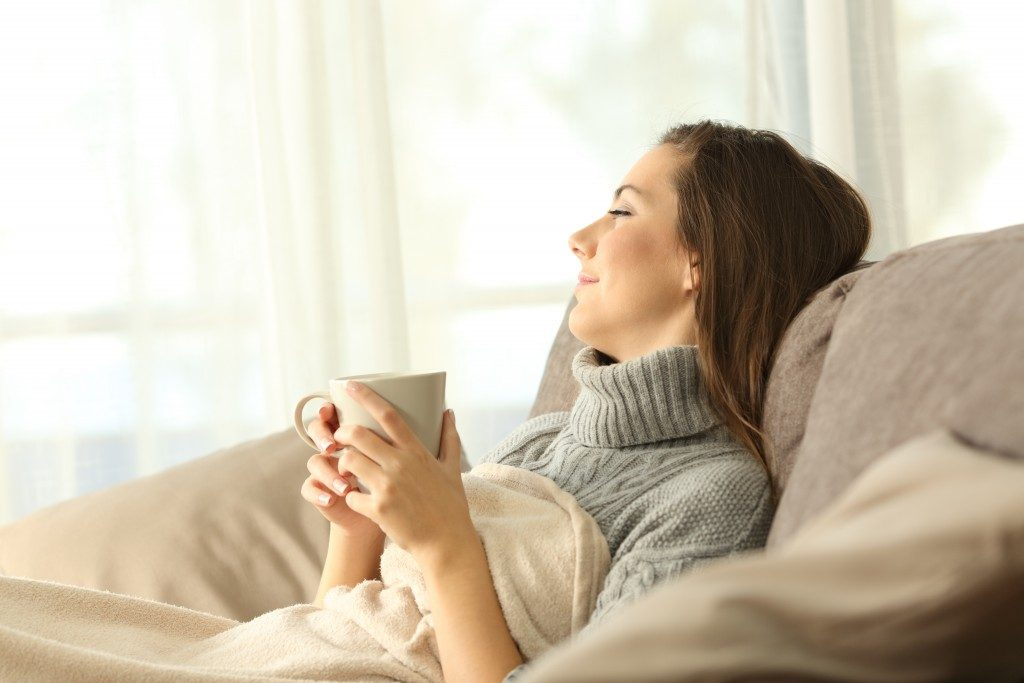 woman enjoying coffee on the couch