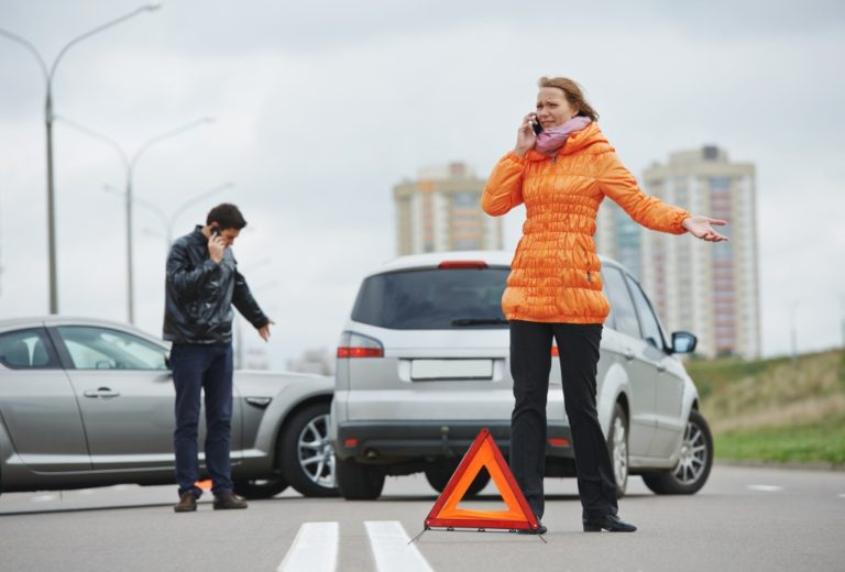woman calling after car accident on the road