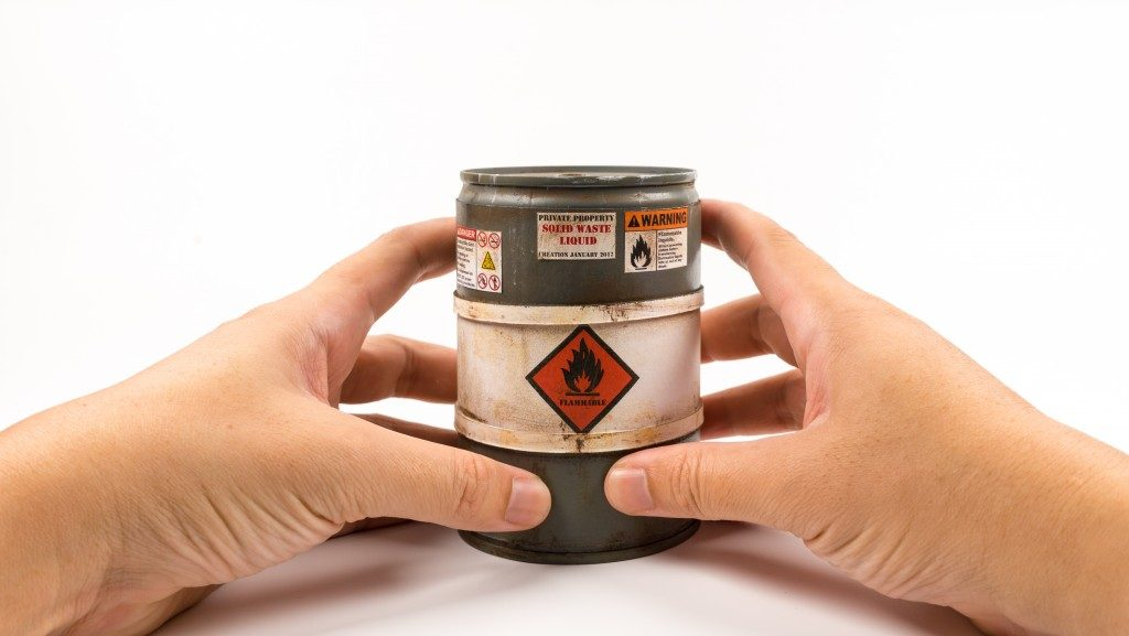 hands holding an unopen lubricant can