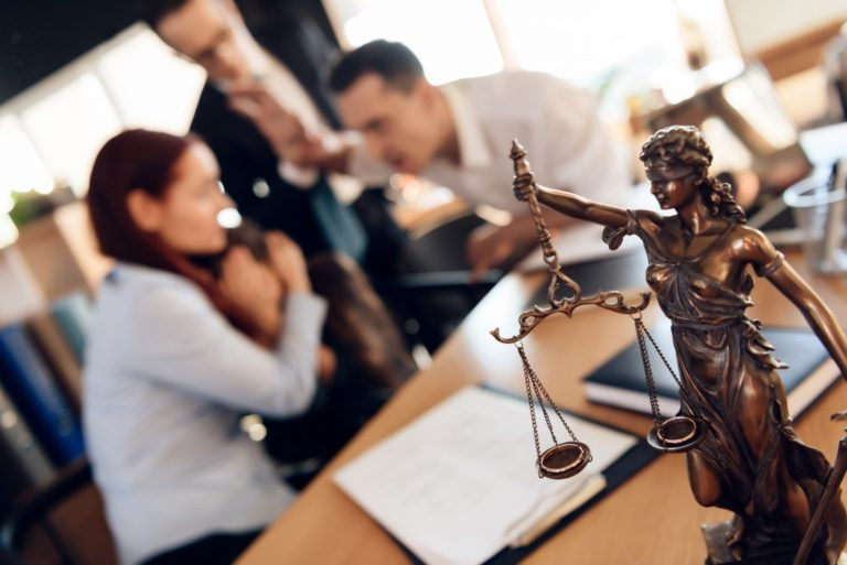 Lady justice figure with couple arguing about divorce with their lawyer and their daughter