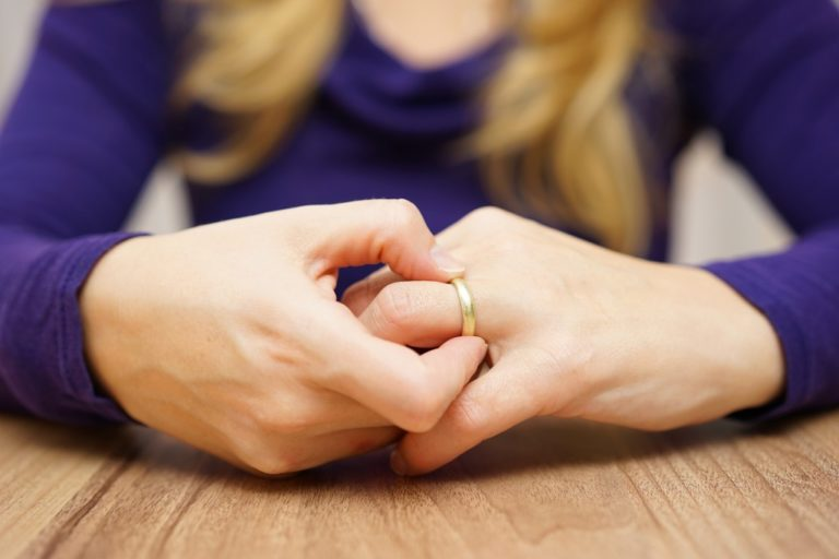 woman holding her wedding ring