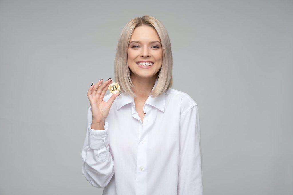 woman holding a gold coin