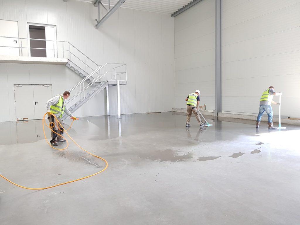 men cleaning the floor